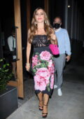 Sofia Vergara wears a see-through top with a floral print skirt during a rare outing with her son in West Hollywood, California