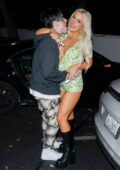 Tana Mongeau packs on some serious PDA with boyfriend Chris Miles during a night out in Los Angeles