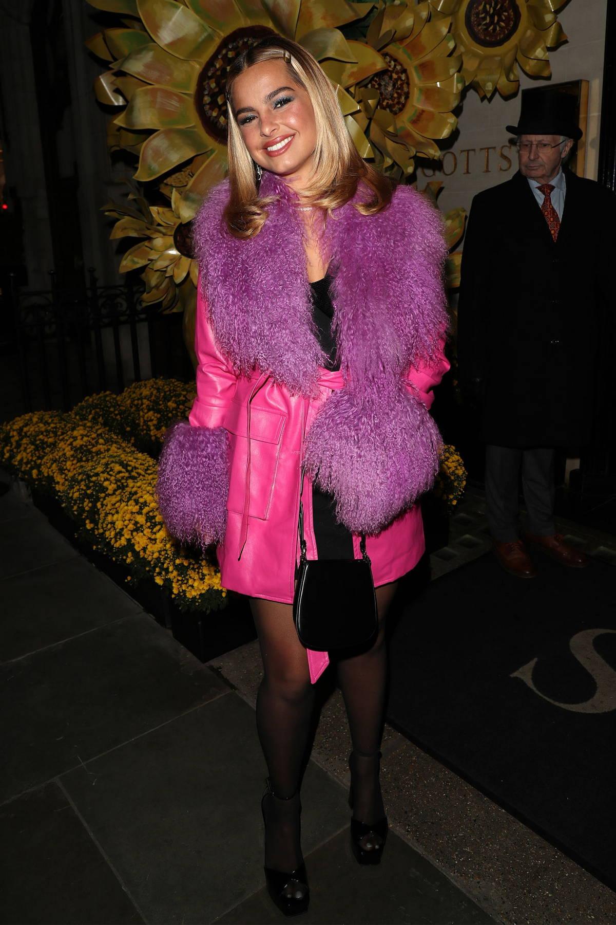 Addison Rae looks pretty in pink as she arrives for dinner at Scott's Mayfair Restaurant in London, UK