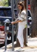 Alessandra Ambrosio looks fab in a striped sweater and white leggings while out for lunch in Beverly Hills, California