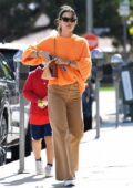 Alessandra Ambrosio looks striking in an orange sweater and flared denim while running errands in Brentwood, California