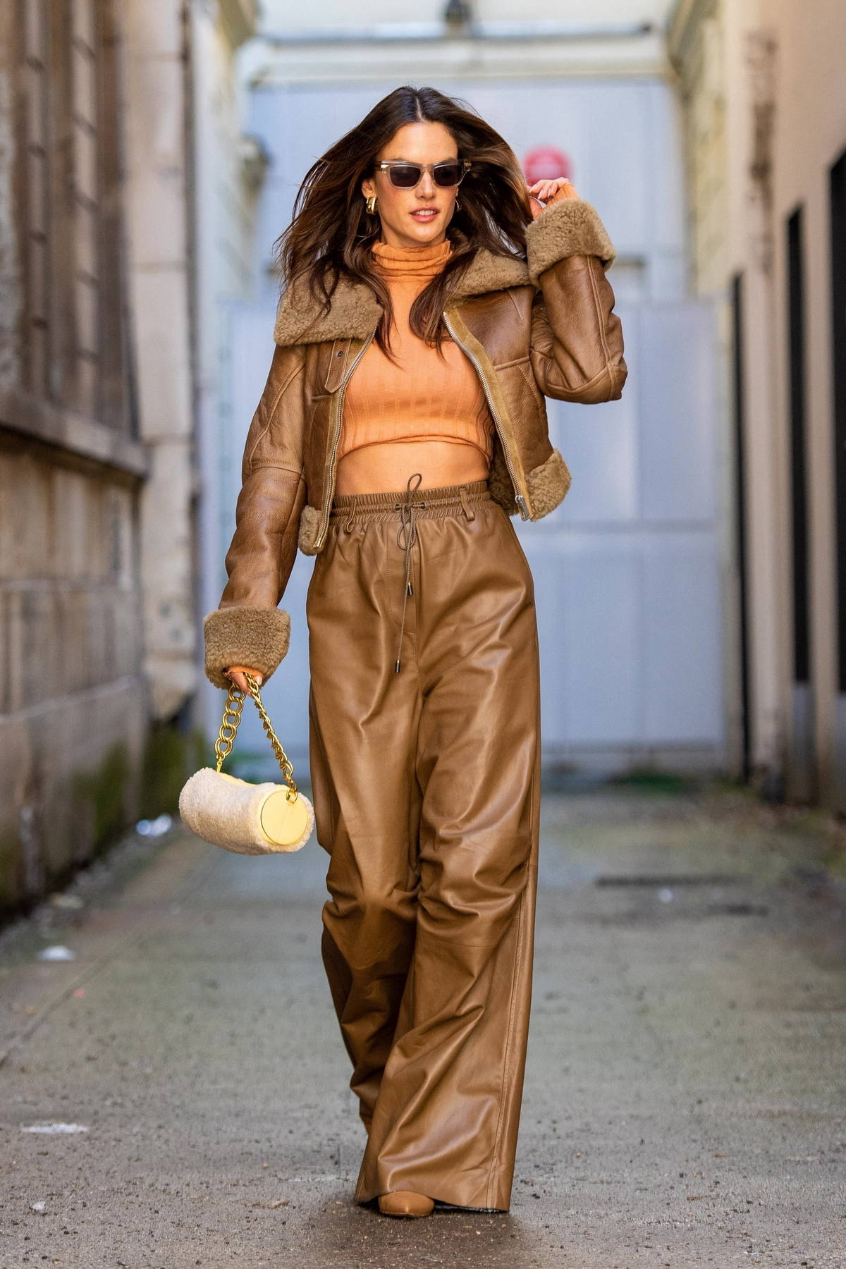 Alessandra Ambrosio looks stunning in brown leather jacket with matching pants during Paris Fashion Week in Paris, France