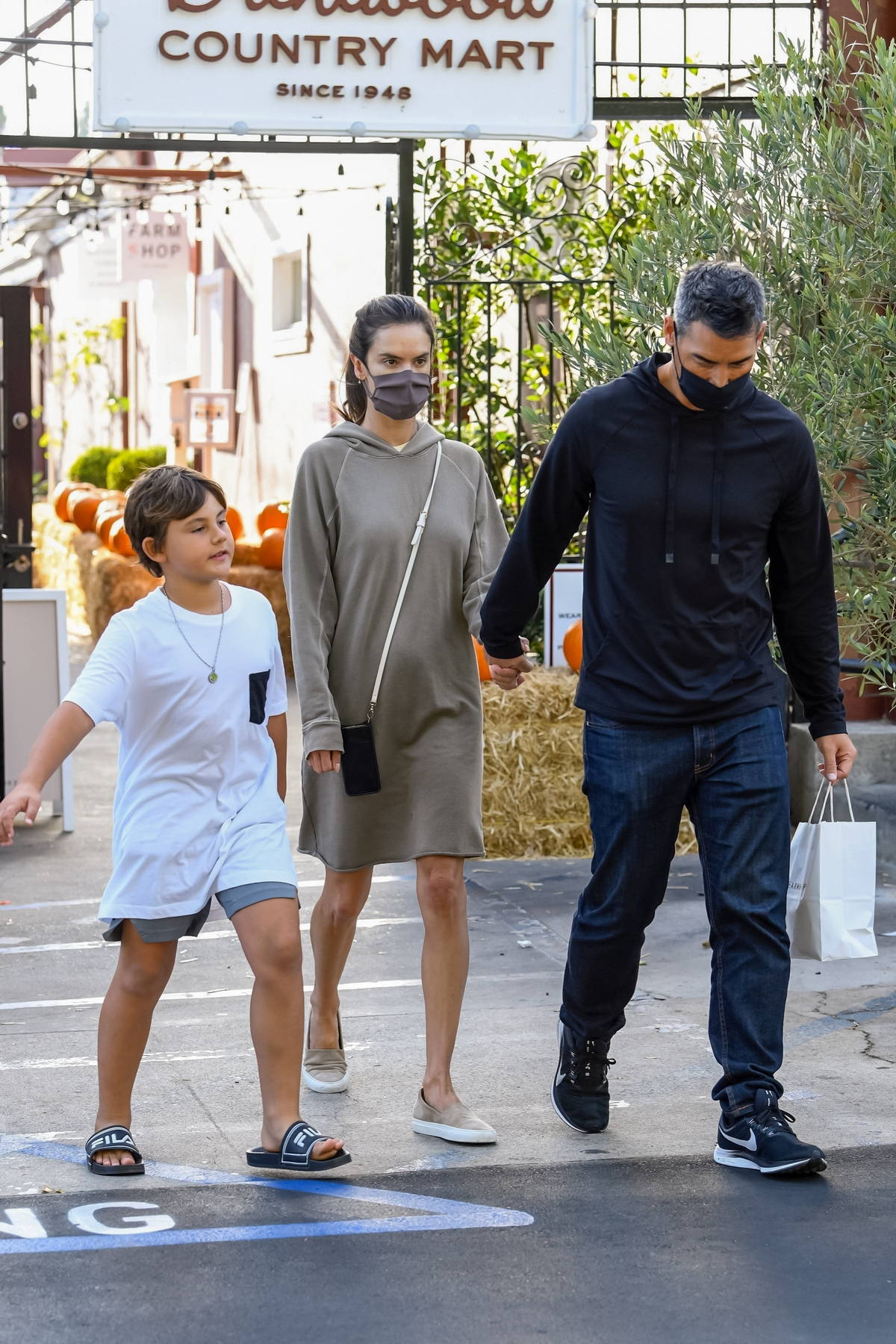 Alessandra Ambrosio opts for a casual hoodie dress while picking up lunch with boyfriend Richard Lee and her son in Brentwood, California