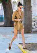 Alessandra Ambrosio puts on a leggy display in a khaki romper while running a few errands in Los Angeles