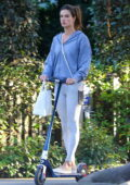 Alessandra Ambrosio sports a blue hoodie and grey leggings while running errands on her scooter in Brentwood, California