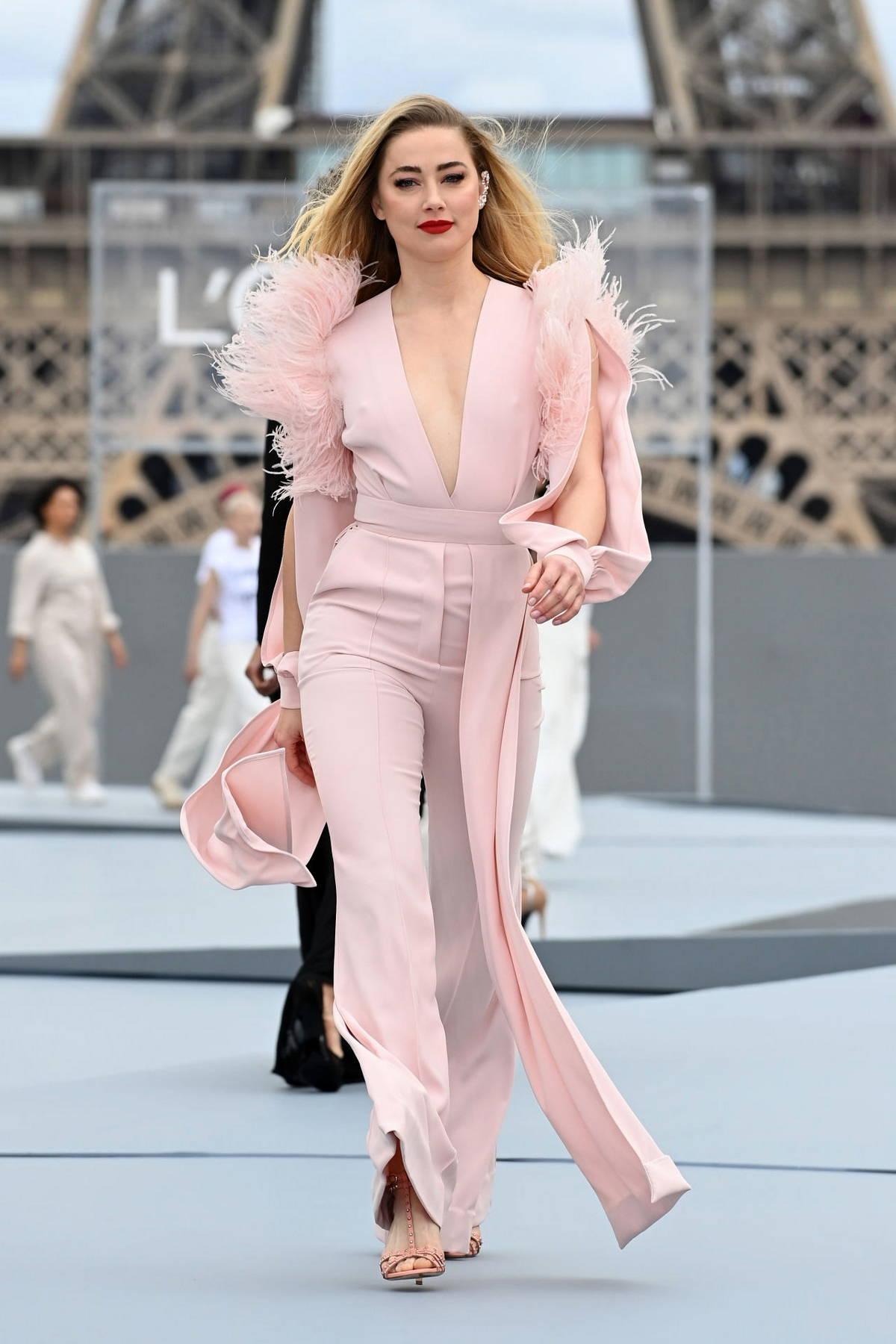 Amber Heard walks the runway for the Le Defile L'Oreal Paris 2021 Show during Paris Fashion Week in Paris, France
