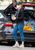 Amy Adams wears a black hoodie and blue leggings while out running errands in Beverly Hills, California