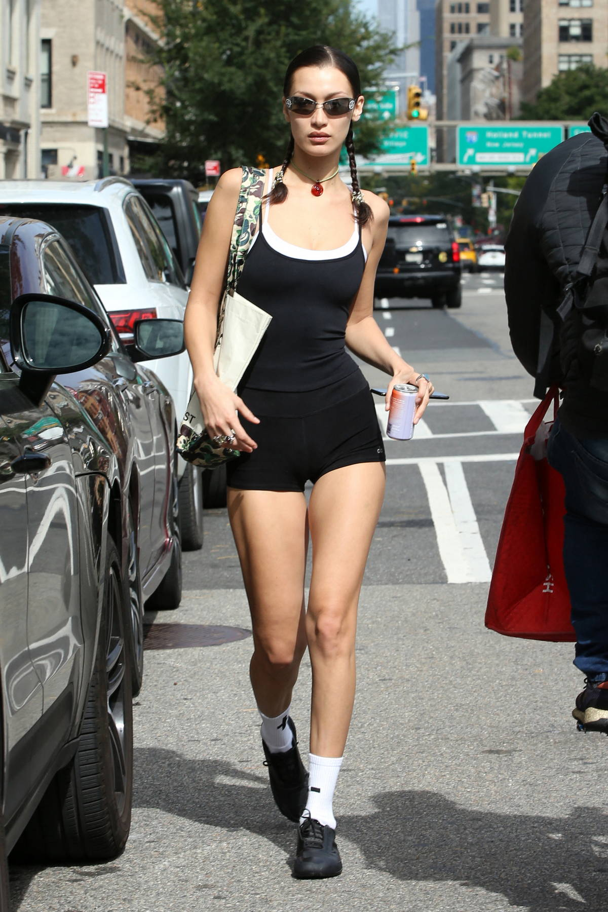 Bella Hadid flaunts her perfectly toned legs in tiny black shorts as she leaves after a workout session in New York City