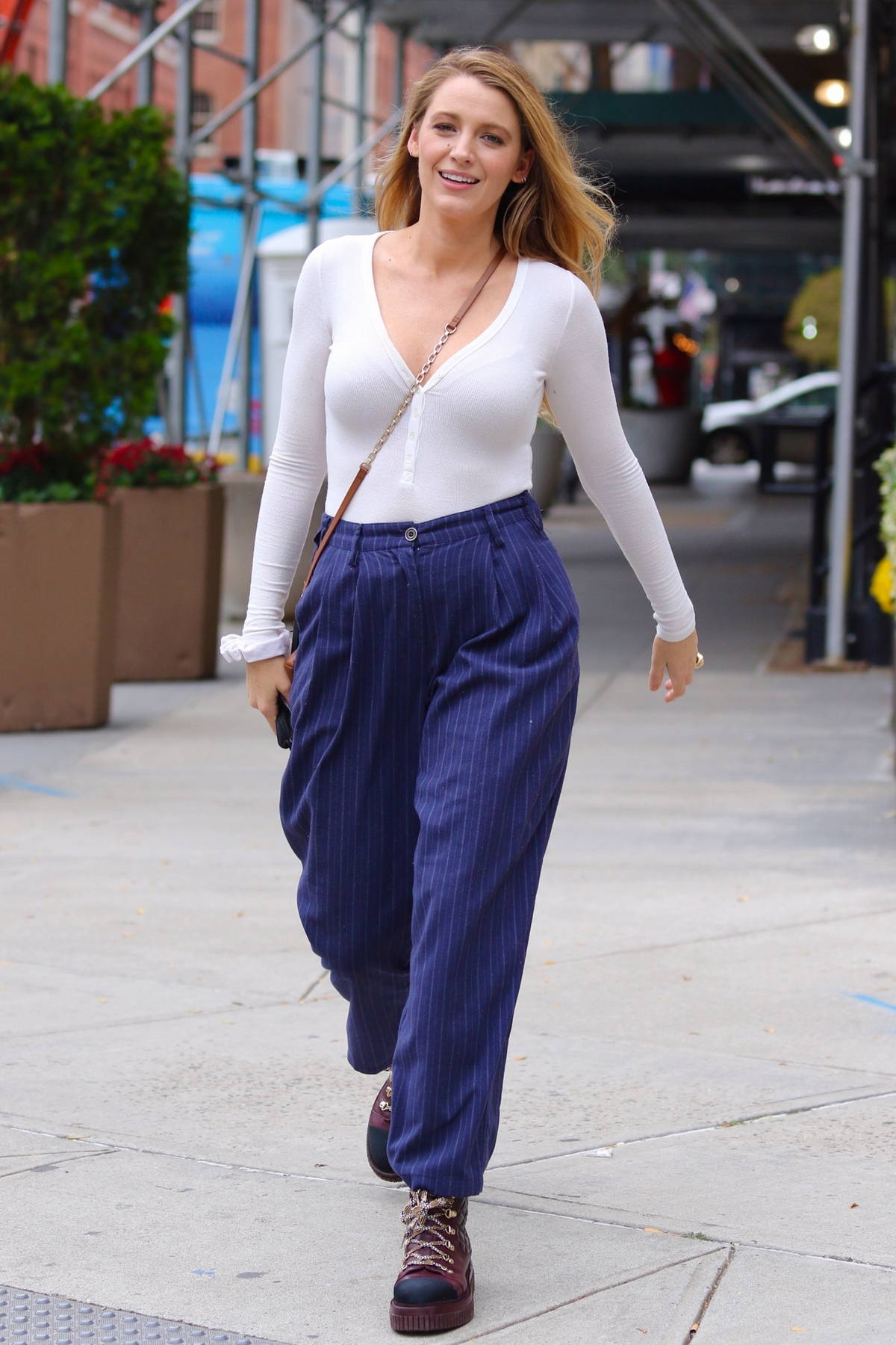 Blake Lively looks stylish wearing a white long-sleeve top and striped blue pants while running errands in New York City