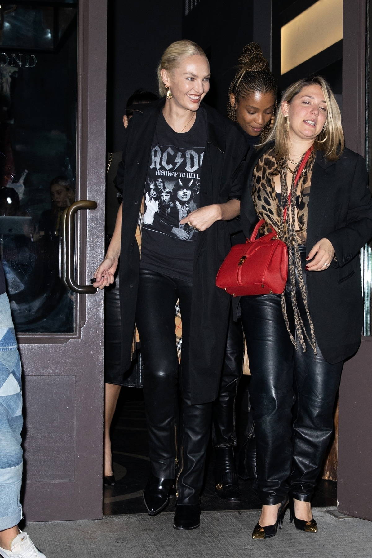 Candice Swanepoel rocks an ACDC T-shirt and leather pants while celebrating her 33rd birthday with friends in New York City