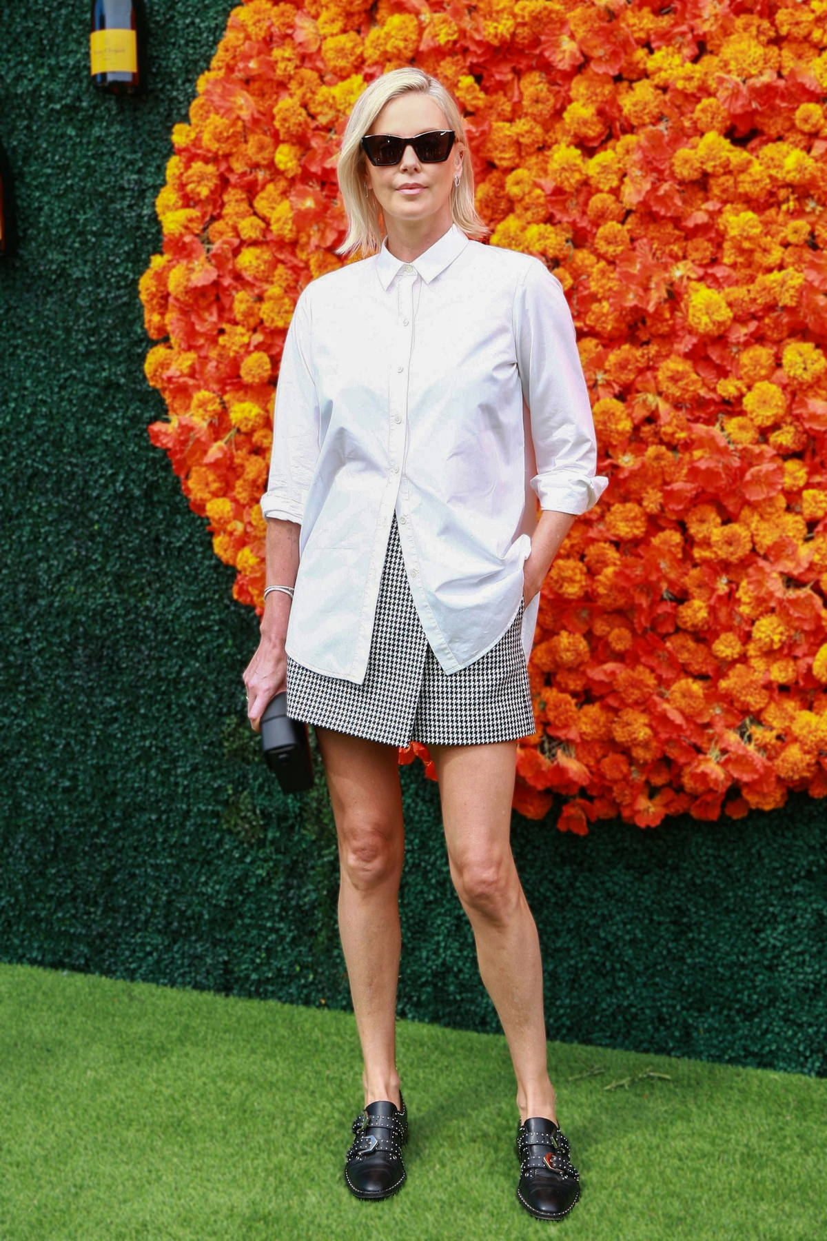 Charlize Theron attends the Veuve Clicquot Polo Classic at Will Rogers State Historic Park in Pacific Palisades, California