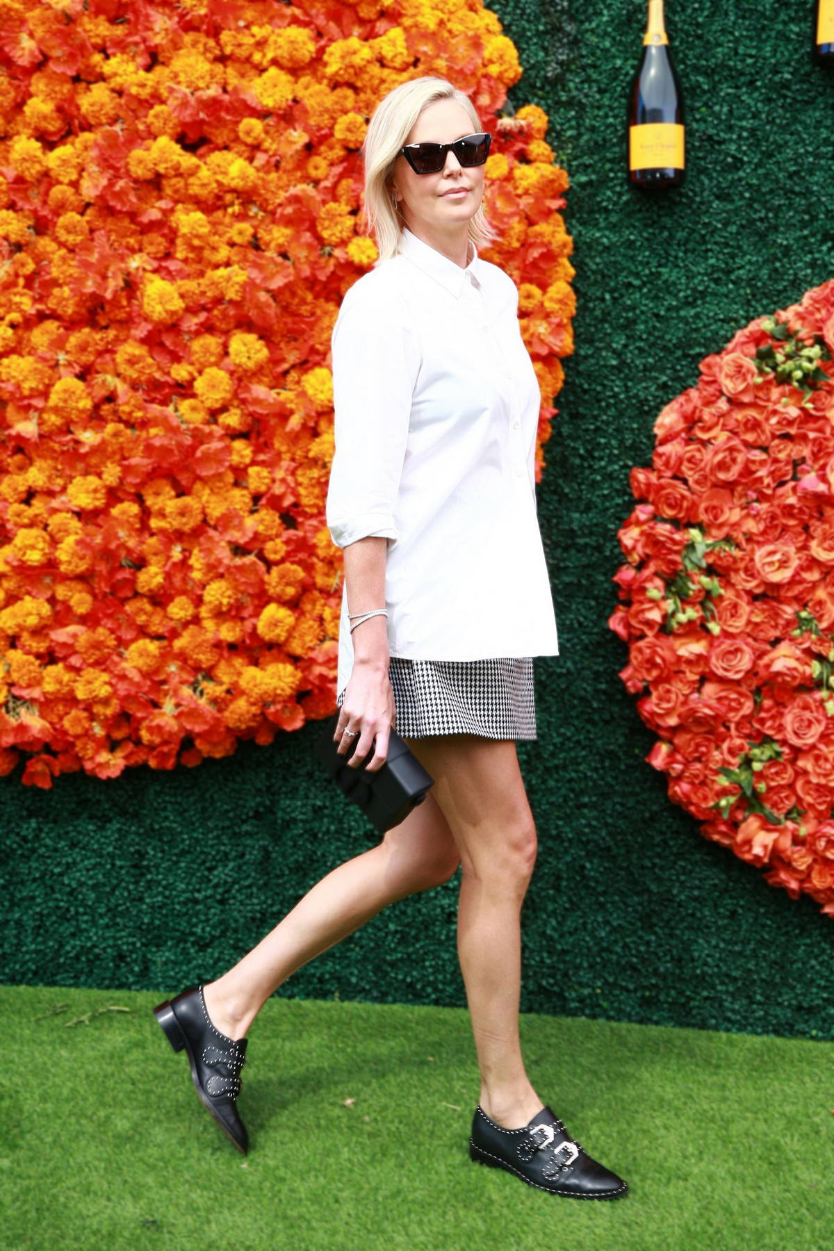 charlize theron attends the veuve clicquot polo classic at will rogers  state historic park in pacific palisades, california-021021_5