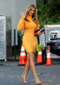 Chrishell Stause looks striking in an orange sweater dress as she wraps up filming 'Selling Sunset' in West Hollywood, California