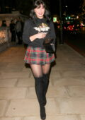 Daisy Lowe looks great in a tartan mini skirt knee, high boots, and hoodie while attending Fiorucci fashion party in London, UK
