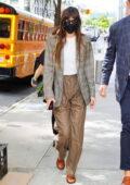Dakota Johnson steps out wearing a plaid blazer in New York City