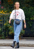 Diane Kruger shows off her massive engagement ring during a morning walk with mom in New York City