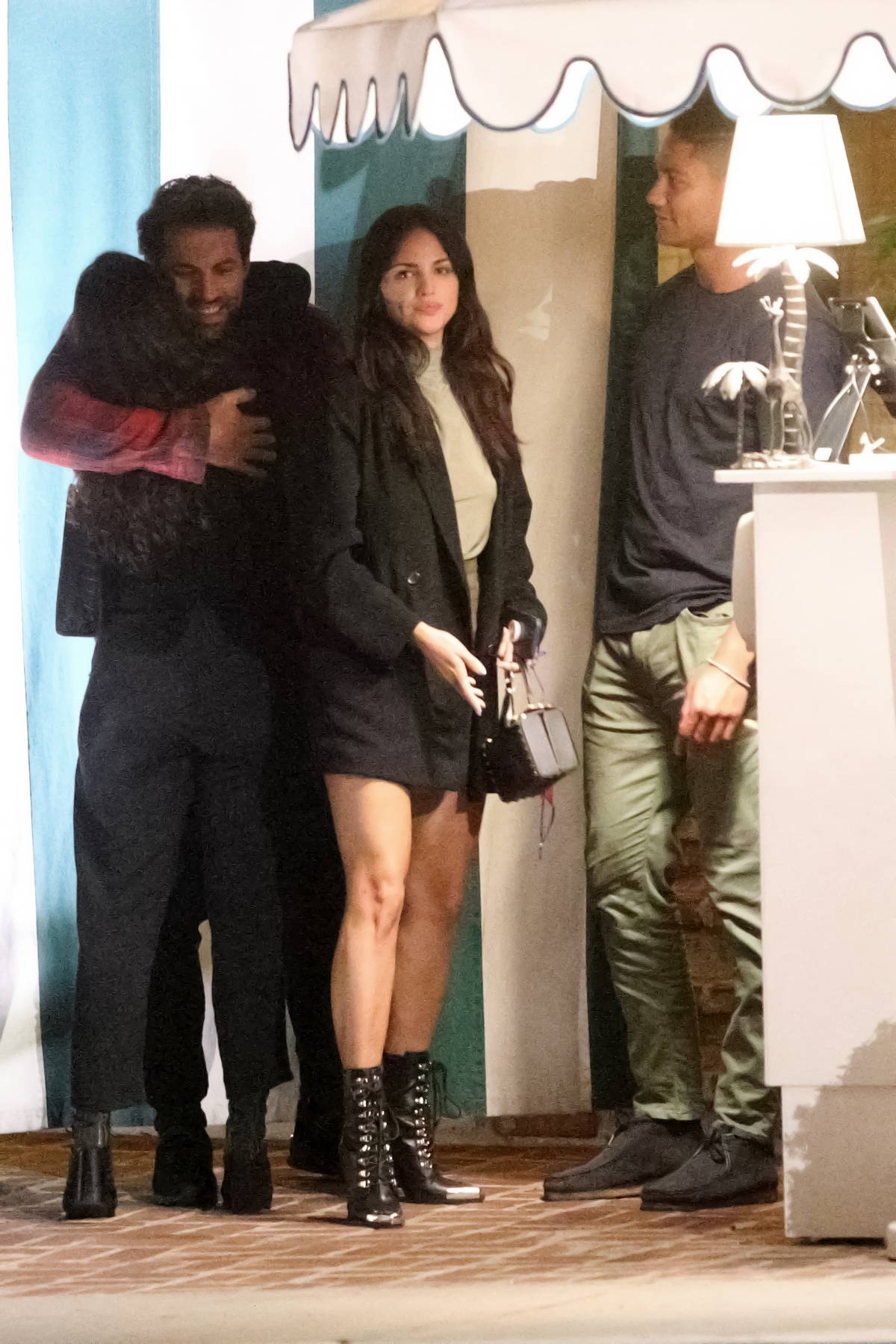 Eiza Gonzalez shows off her legs in a mini skirt during a double date in West Hollywood, California