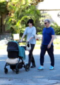 Elsa Hosk enjoys a stroll with her father and daughter Tulukki near her home in Pasadena, California
