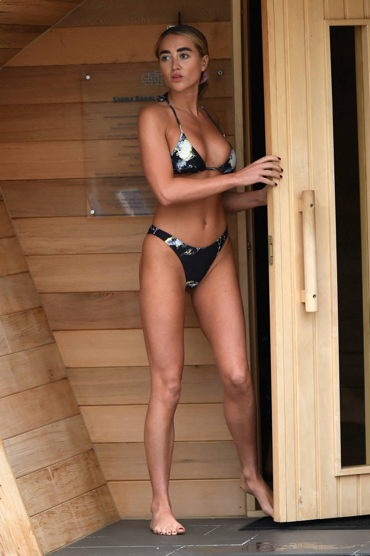 Georgia Harrison spotted in a bikini while enjoying a relaxing day at the Glass House retreat in Essex, UK