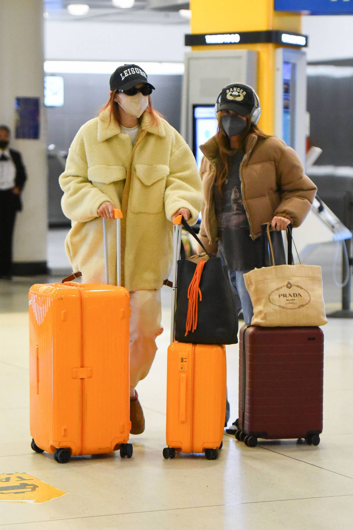 Gigi Hadid keeps it cozy in a yellow fleece and joggers as she touches down at JFK Airport in New York City