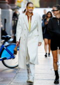 Gigi Hadid looks chic in a white coat while stepping out for a stroll in New York City