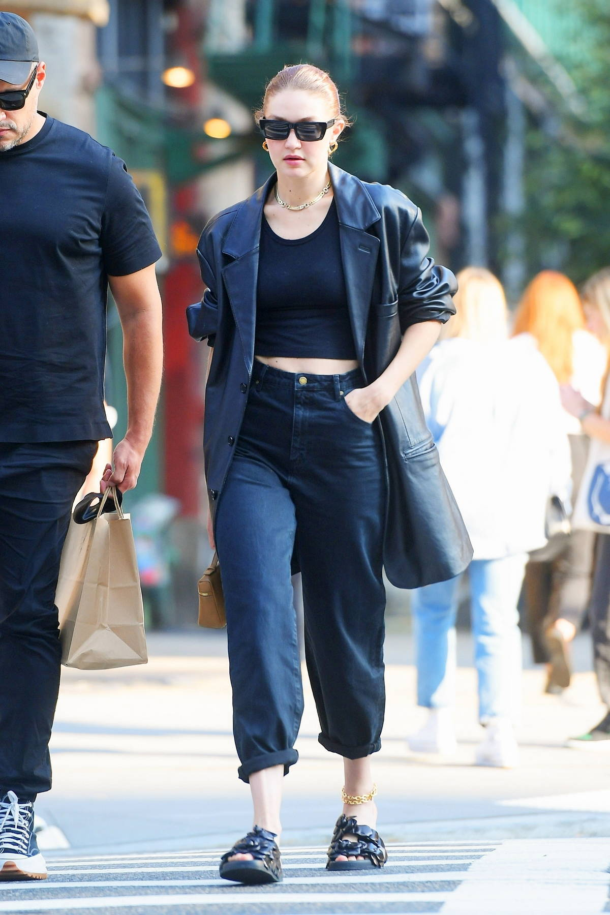Gigi Hadid steps out looking stylish in a black leather jacket paired with a matching top and denim in New York City