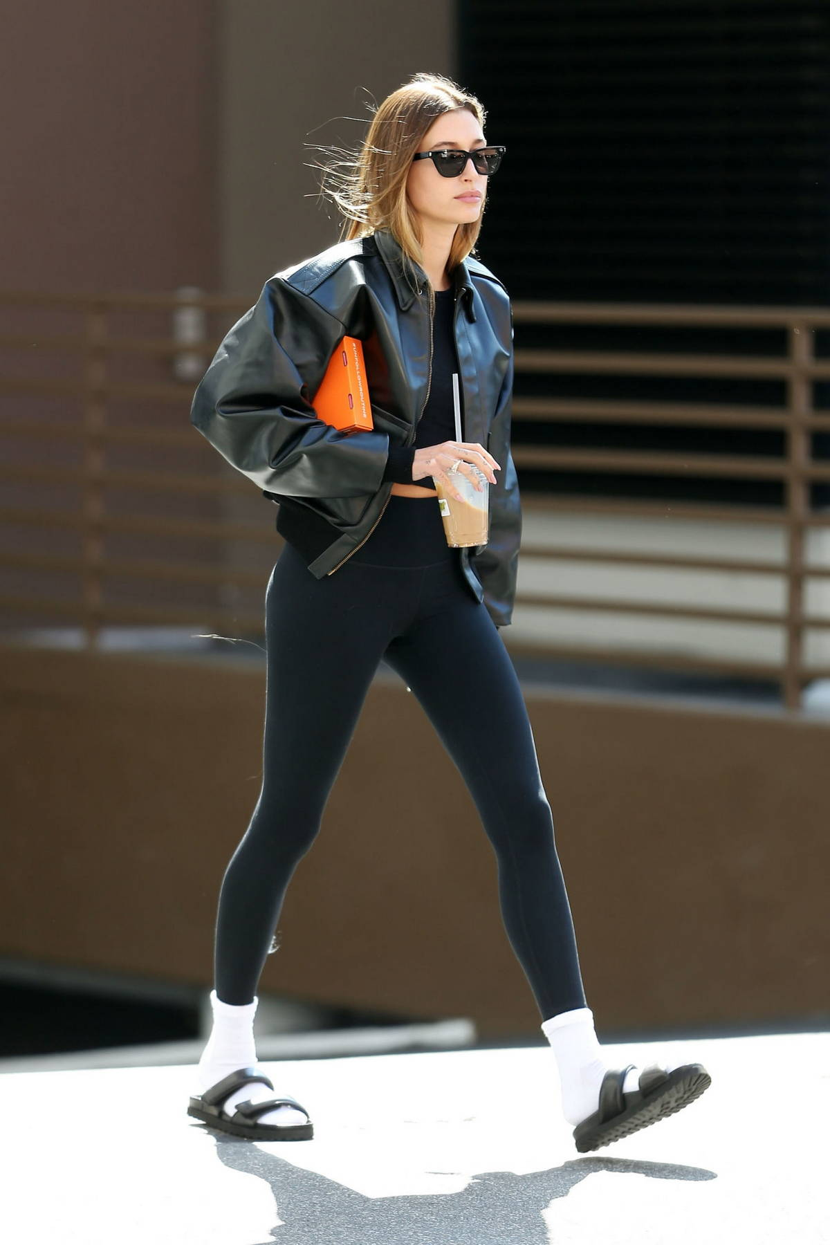 Hailey Bieber rocks a black leather jacket and leggings while heading for a meeting in Los Angeles