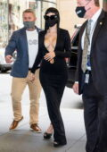Halsey flaunts her curves in a plunging black dress as she arrives at the NBC studios in New York City