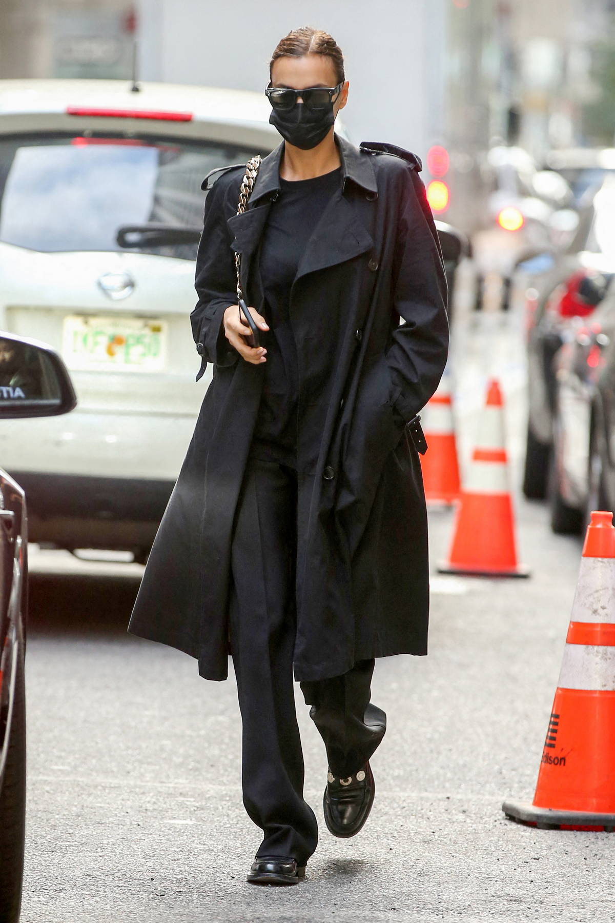 Irina Shayk looks fashionable in a black Burberry trench coat while stepping out in New York City