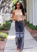 Jasmine Tookes looks trendy in a beige tank top and denim during a shopping trip to Violet Grey in Los Angeles