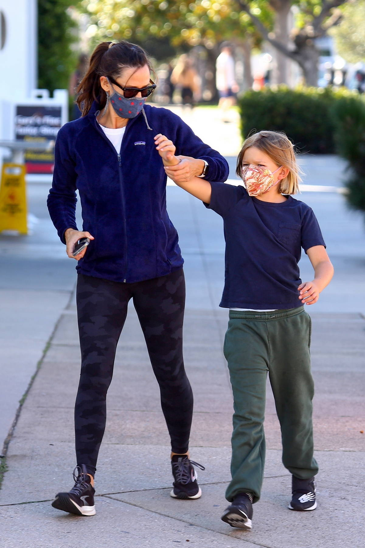 Jennifer Garner picks up some fresh produce and flowers while shopping at a farmer's market with her son in Brentwood, California