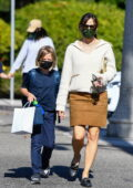 Jennifer Garner wears a white sweater and brown suede skirt while she picks up her son from school in Brentwood, California