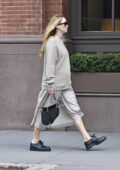 Jennifer Lawrence shows her growing baby bump in a grey sweater and Christian Dior handbag while out in New York City