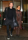 Jennifer Lopez and Ben Affleck hold hands as they check out of the Mandarin Hotel in New York City