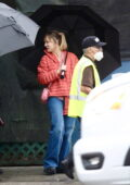 Kaley Cuoco seen wearing an orange puffer jacket while on the set of 'The Flight Attendant', Season 2 in Los Angeles
