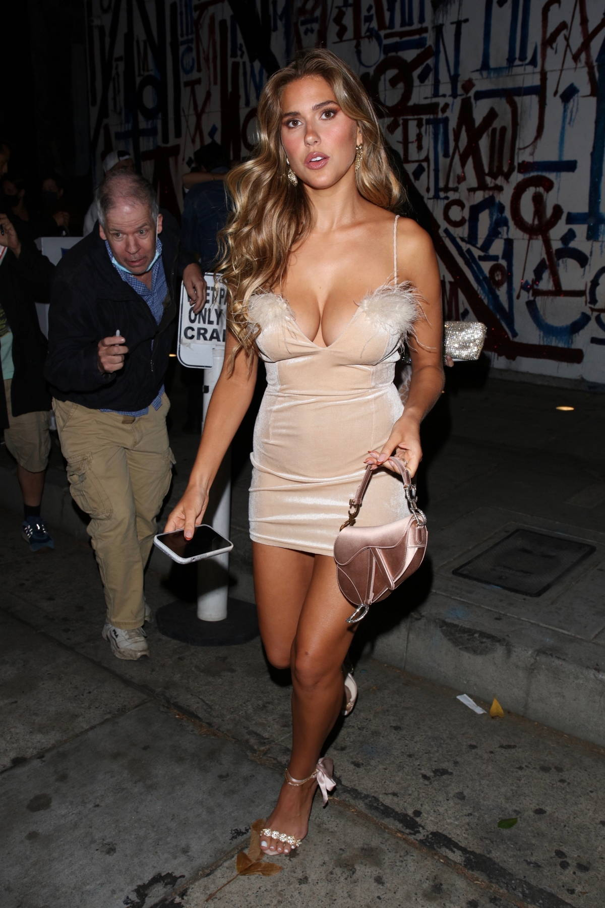 Kara Del Toro flaunts her curves in a plunging mini dress while out for dinner at Craig's in West Hollywood, California