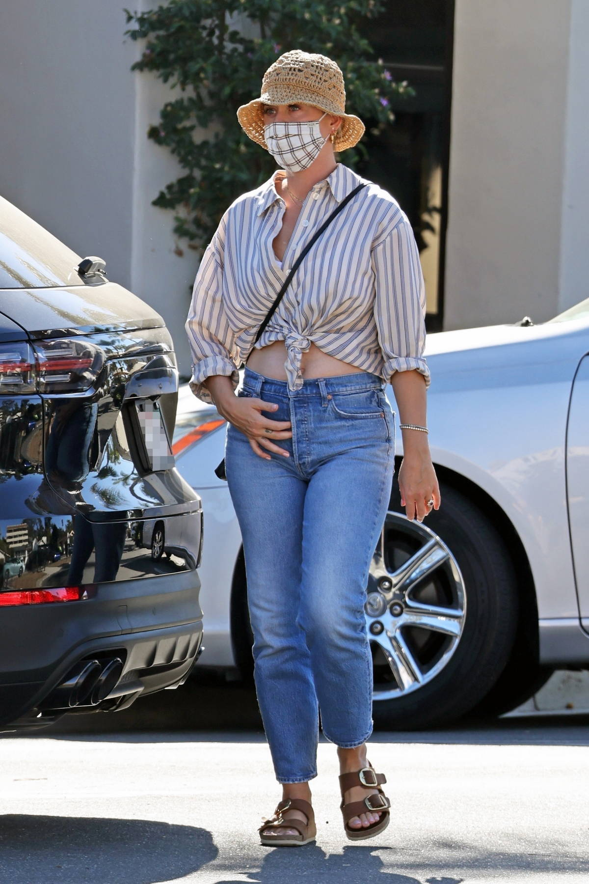 Katy Perry wears a knotted shirt and jeans while out shopping in Santa Barbara, California