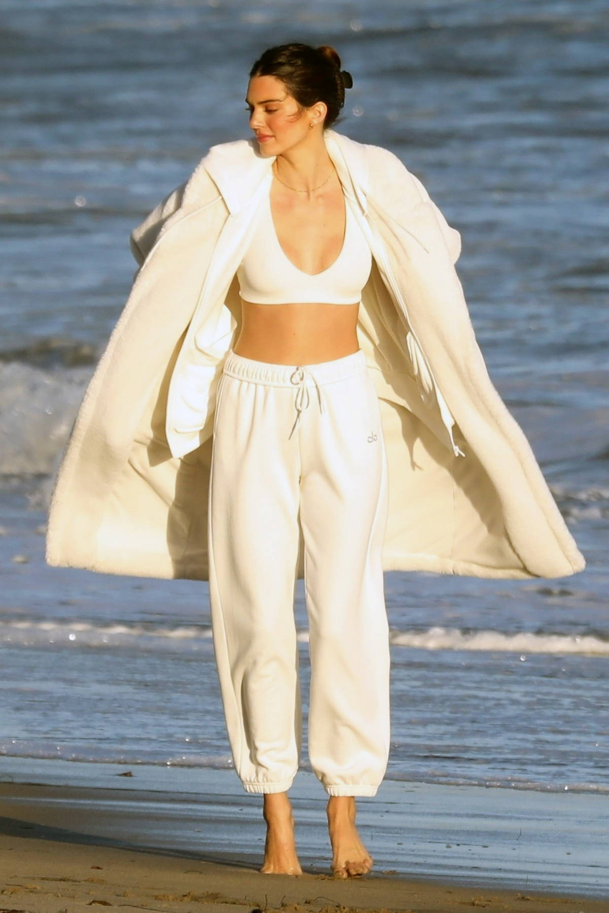 Kendall Jenner looks radiant during a beach photoshoot for Alo Yoga in Malibu, California