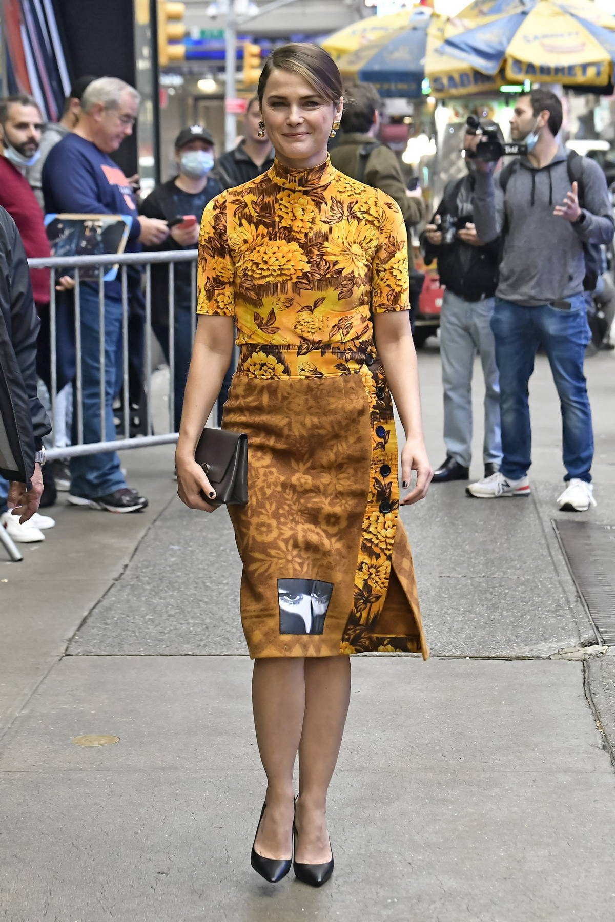 Keri Russell wears a floral print dress as she arrives for an appearance on 'Good Morning America' in New York City
