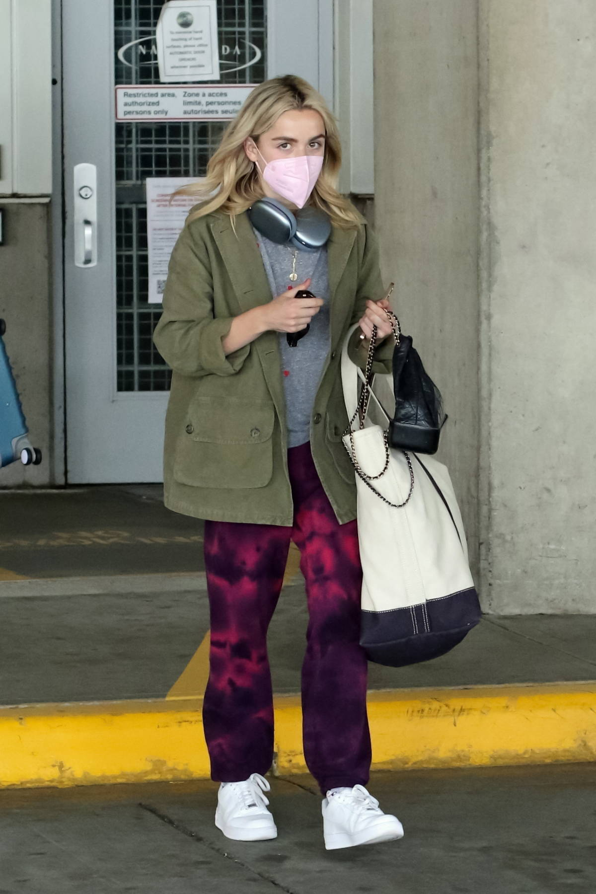 Kiernan Shipka keeps it casual as she arrives at Vancouver International Airport in Vancouver, Canada