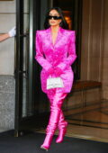 Kim Kardashian dazzles in hot pink as she leaves The Ritz-Carlton for another day of SNL rehearsals in New York City