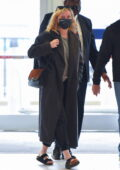 Kirsten Dunst looks cozy in a warm long coat as she arrives at JFK Airport in New York