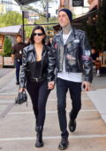 Kourtney Kardashian and boyfriend Travis Barker hold hands while enjoying a stroll around New York City