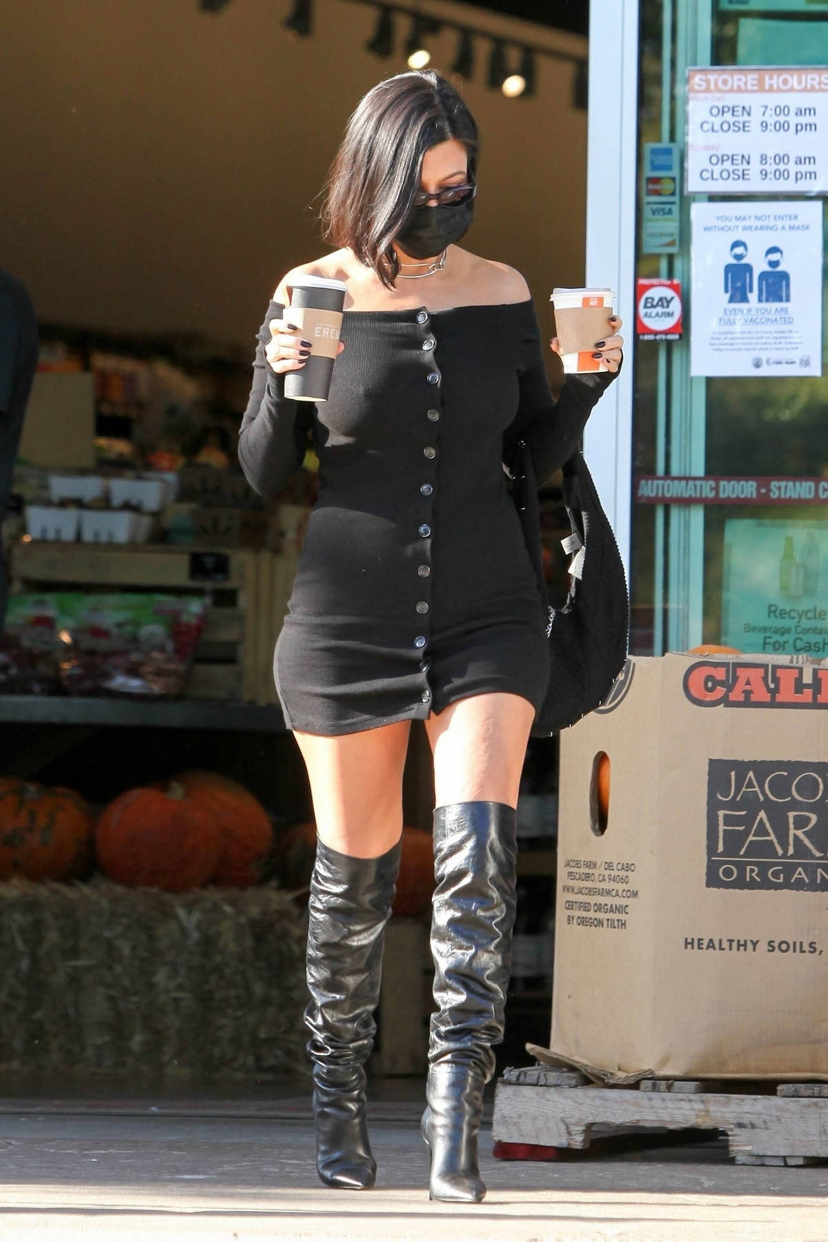 Kourtney Kardashian gets leggy in a short black dress while making a coffee run at Erewhon Market in Calabasas, California