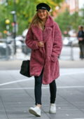 Laura Whitmore stays warm in a furry pink coat as she arrives at the BBC Broadcasting House in London, UK