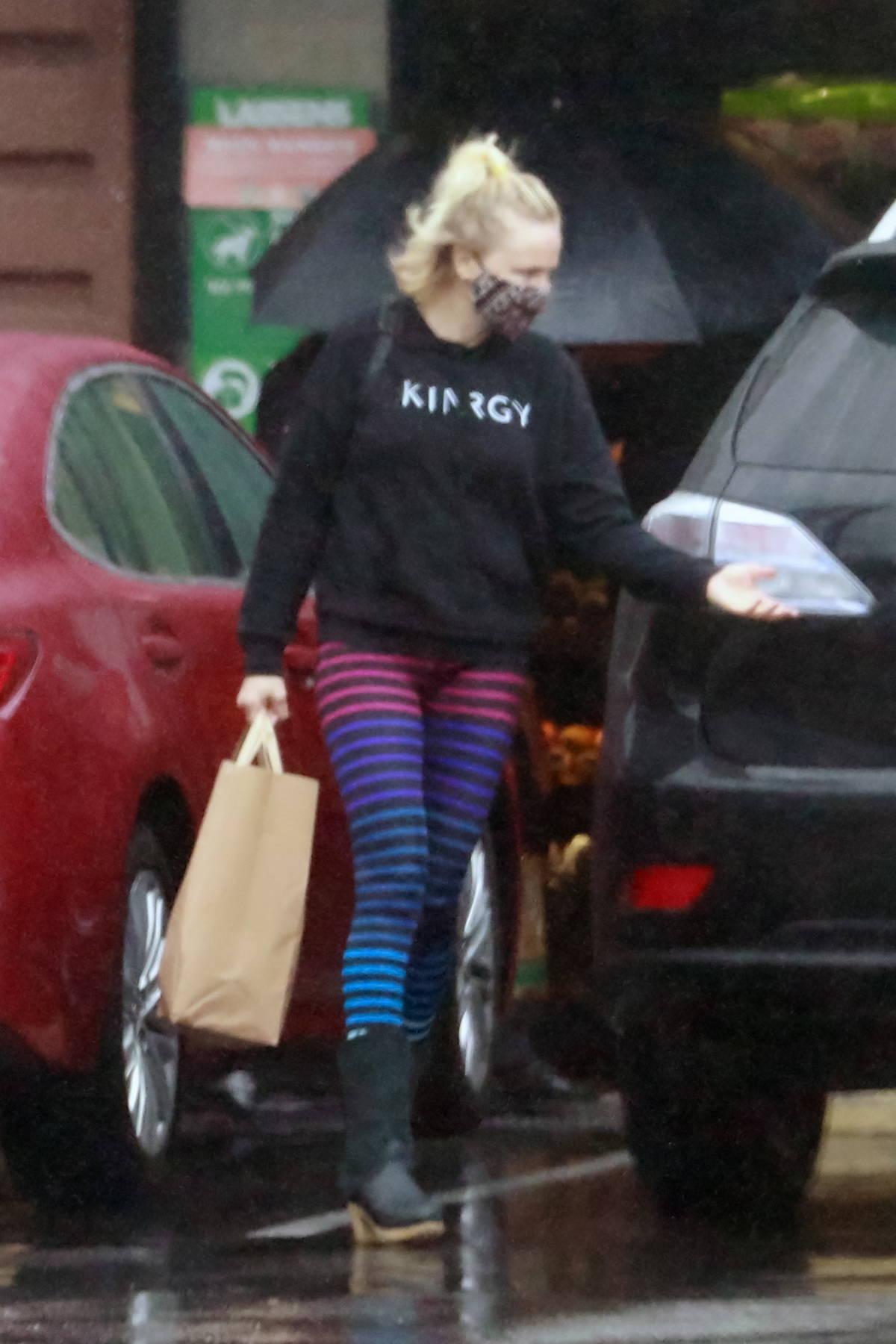 Malin Akerman makes a quick grocery run on a rainy day in Los Feliz, California