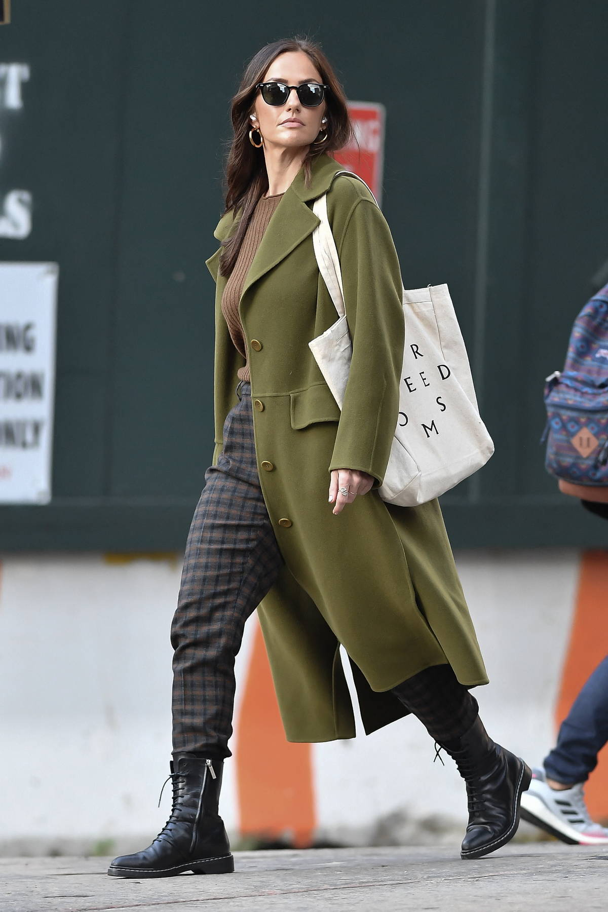 Minka Kelly looks stylish in an olive green trench coat while out running errands in New York City