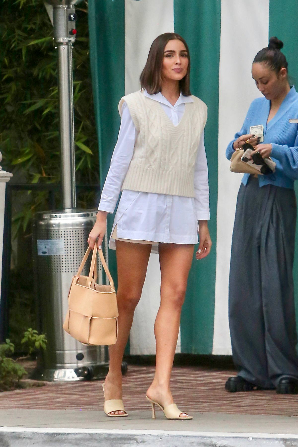 Olivia Culpo shows off her slender legs while out for lunch with Cara Santana in West Hollywood, California