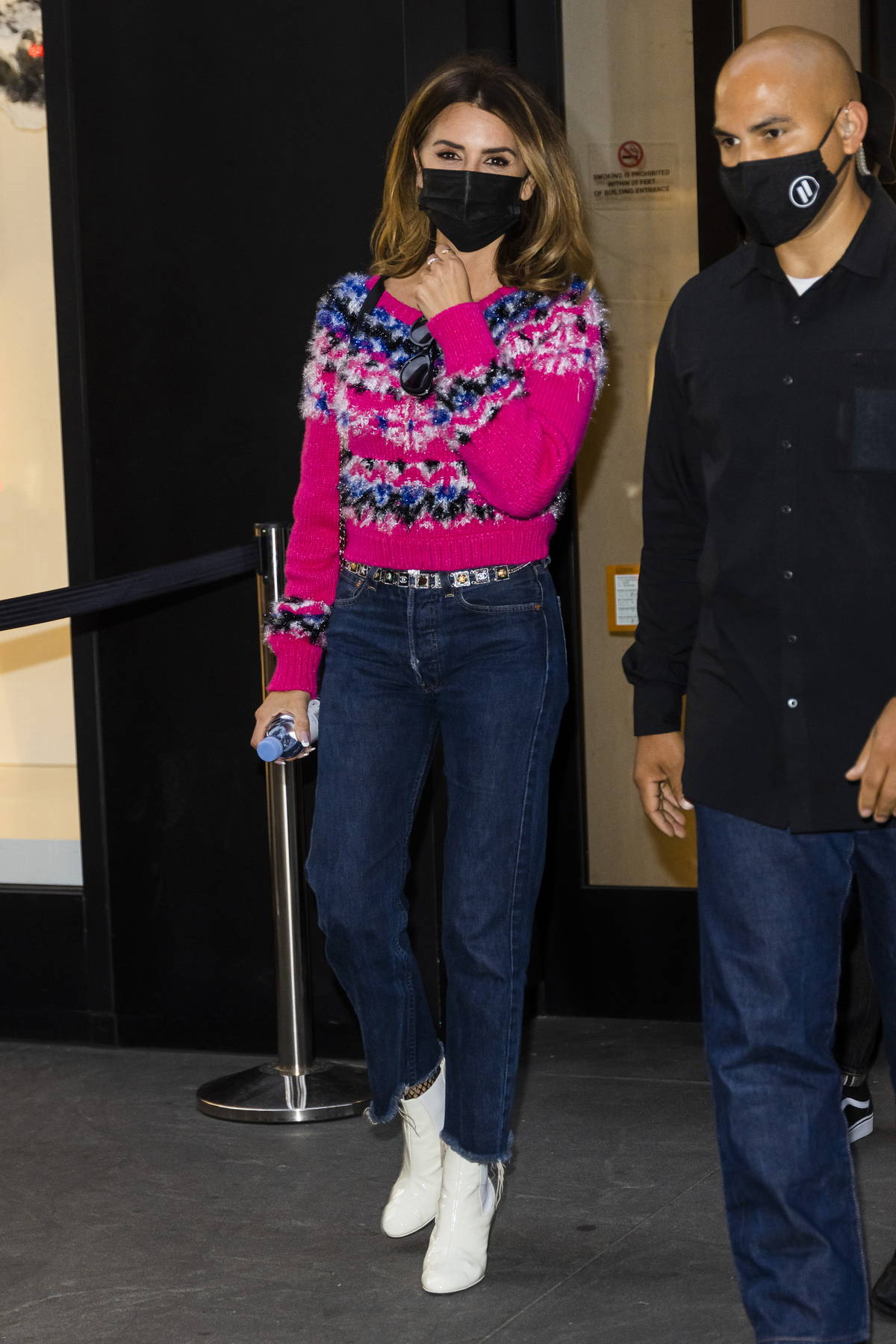Penelope Cruz steps out looking fashionable in a pink sweater and jeans in New York City