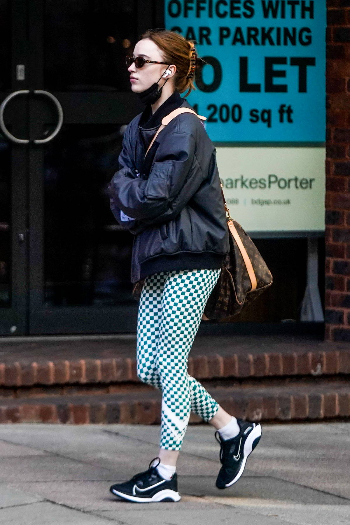 Phoebe Dynevor looks sporty in checkered leggings, sneakers and black jacket while stepping out in London, UK